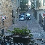 Tiny street sweeper is cleaning the cobble stone streets