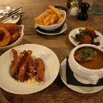 "Onion Rings, ""hand cut"" chips (1.99e) Vegetable Soup (3.95) Courgette Fritters, Risotto balls"