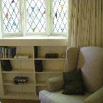 stained glass windows in master bedroom reading area