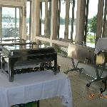 sunroom set up for food service for wedding