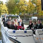 taking wedding party for pontoon boat ride