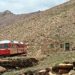 A great view of a train passing the crew house at Windy Point, elevation 12,129 feet.