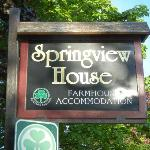Farm house sign at the road