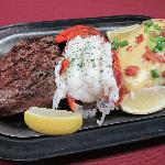 Steak and lobster with loaded baked potato