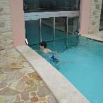 Door between indoor and outdoor pool