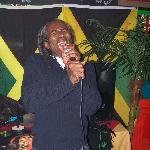 Golty Farabeau singing at El Gringos