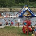 Man made murky pond with inflatable slide