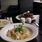 Steak & chips; salmon & prawn linguine - and the smaller portion is my granddaughter's meal!