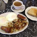 Eggs, sausage, home fries, rye toast and coffee