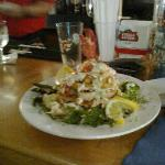 lobster tower with haddock at base popcorn shrimp scallops and a light cream sauce