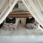 The bed, with lovely cushions