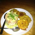 Delicious ceviche with fried plantains