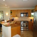 Fully equipped kitchen with granite and stainless steel appliances