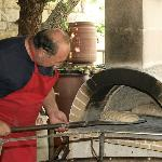 Baking the bread in traditional wooden oven