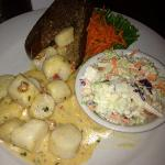Scallops with a side of coleslaw. $19