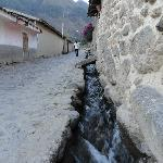 Ancient water supply running down the street in front