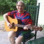 Dennis playing sweet music on the front porch