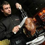 Gauchaos hand carve meats at your table.