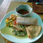 Tamale with corn salsa and guacamole