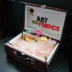 Sharing Cocktails Served in Suitcase