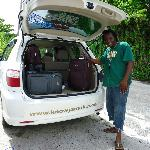 Javia loading the car between villas - Port Antonio
