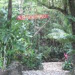 The Hotel Buenisimo sign with some of the beautiful scenery in the background