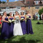 The bride and bridesmaids in the garden
