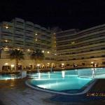 Hotel and pool are by night