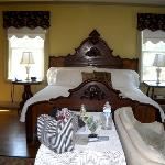The beautiful antique bed and sofa in this huge room