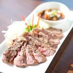 chargrilled rib eye steak with tangy cracked rice dip