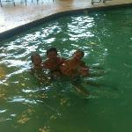 my 12 year old and 7 year old triplets in the pool