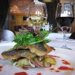 Pan fried seabream fillets served withw arm potato and red onion rocket salad with a lemon dress