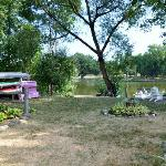 Backyard with river, kayaks, canoe, paddleboat, campfire