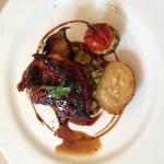 Guinea fowl atop summer vegetables