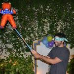 Jose trying to find his surprise pinata hung in the shared courtyard