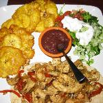 Yummy Tico Meal, double fried plantains, fajitas, and salad