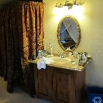 The lavatory and mirror in our room.