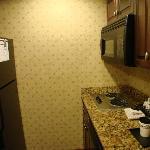 full size refrigerator, microwave, 2 burner stove