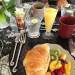 Homemade croissant at a beautifully set breakfast table for two.