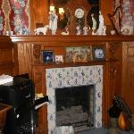 Lovely fireplace & mantel in dining room