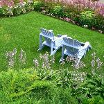 Meticulous lawn w/adirondack chairs