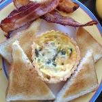 Quiche with bacon and toast