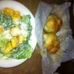 Bread knots and caesar salad.