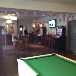Sports area with 2 pool tables and 4 tv screens to watch the games