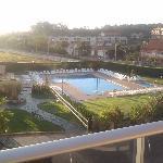 Zona de piscinas desde el balcón de la habitación