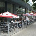 Summer sidewalk patio is great for people watching