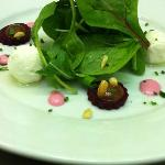 Goat's cheese with pickled beetroot, toasted pine nuts, beetroot mayo, dressed leaves