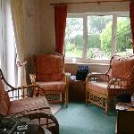 Very nice sitting room off bedroom with nice view of gardens
