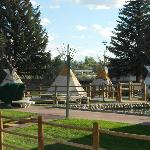 The swimming pool is on left and hot tubs under tee-pee