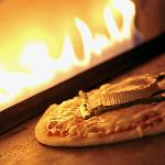 Cooked in our special pizza oven
